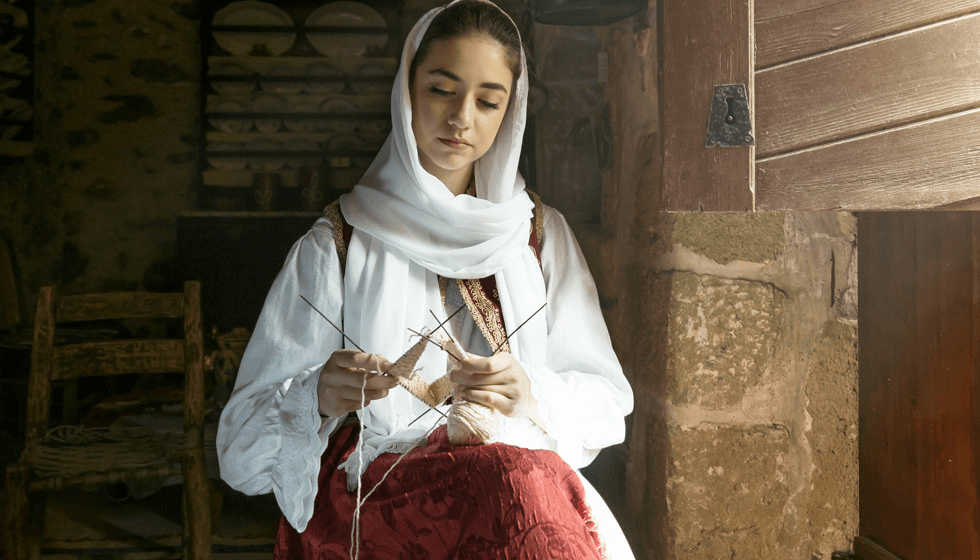 Cretan woman in traditional oufit knitting